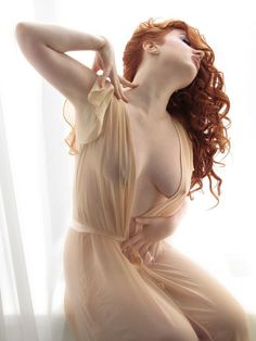 Gorgeous redhead in transparent dress (almost bare) dress