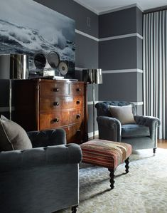 Masculine deep blue gray walls, tufted velvet chairs, antique highboy ~ eclectic