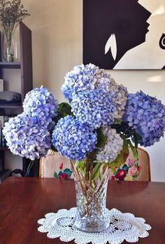 Blue hydrangeas on my table with nanas doily Blue Hydrangea, Hydrangeas, My Flower, Flowers, Doilies, Hanukkah, Wreaths, Table, Home Decor