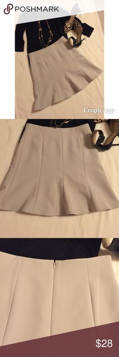 Anne Taylor Skirt Cream/off white skirt,has horizontal panels of fabric running front & back of skirt.fully lined.exterior 92% polyester & 8% spandex.Zip & hook closure on back.In new condition,barely worn.Waist 14.5 inches,length 19 inches.size 4.Smoke free home.❌❌no trades❌❌ Skirts A-Line or Full