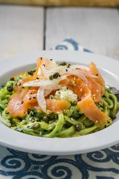 "Cucumber noodles covered in a creamy avocado ""sauce"", topped with thin onion slices, soft cream cheese, smoked salmon ribbons with a sprinkle of capers."