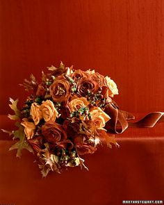 Fall Roses - When bronze roses - 'Orange Unique,' 'Leonidas,' and 'My Lovely' - are paired with golden oak leaves and hypericum berries, the result is undeniably autumn.