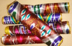 Atlas ikat: the fine, dense, colorful warp yarns literally cover or obscure the less dense, solid-colored, usually white or red, weft yarns. Often about 7m long ranging from 24-26cm in width.