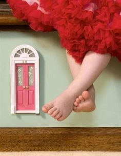 a fairy door on the stairs.