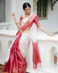 White Red Traditional Silk Wedding Saree - - I just realised after all the lehenga-lehenga talk, I need to talk about wedding sarees. Bridal Kanjeevaram Sarees to be more specific. Bridal Sarees South Indian, Wedding Silk Saree, Indian Bridal Fashion, Indian Bridal Wear, Indian Wedding Sarees, Bride Indian, Kerala Bride, Hindu Bride, South Indian Weddings