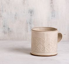 this ellegant coffee cup will make your mornings brighter! White coffee mug in…