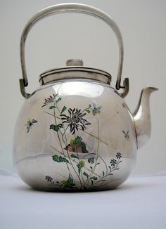 Reverse side of unusual Japanese sterling silver teapot with champlevé enamel in a naturalistic design including bee and dragonfly motifs. (*salamandre*)