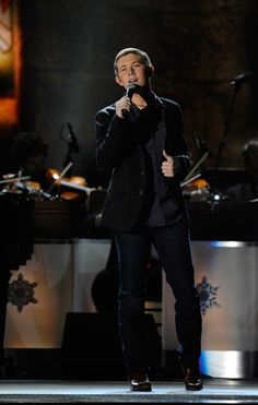 """American Idol"" victor Scotty McCreery wows the crowd with ""The First Noel"" during ""CMA Country Christmas"" on ABC (12/1/11)."