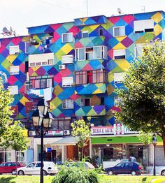 The 30 Most Colorful Buildings in the World via Brit + Co.13. Residential building, Albania: Geo pattern + colors = success. Albanian residents in this neighborhood can never complain about drab surroundings.