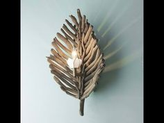 Driftwood Leaf Wall Sconce A capiz petal bobeche and naturally aging brass hardware add layers of intrigue to this wood leaf wall sconce. Distressed driftwood sticks are reclaimed and used in the natural form in which they are found. Beach Crafts, Home Crafts, Diy Home Decor, Driftwood Lamp, Driftwood Projects, Driftwood Ideas, Driftwood Beach, Deco Nature, Creation Deco