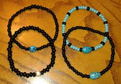 Elastic turquoise and black Czech beads and Swarzski crystal $8 each