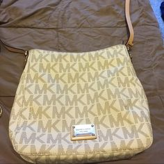 Michael kors cross body white Hello, I have a beautiful Michael kors cross body. It is white. Imperfections are shown in the pictures. Couple stains and the handle is not perfect. Used purse not perfect! Make offers! Michael Kors Bags Shoulder Bags