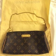 Authentic Louis Vuitton Eva Clutch Bag Authentic Louis Vuitton Eva Clutch Bag in classic monogram print. VERY clean inside and out. Rarely used. Hardware in excellent condition. Patina on bag and strap are in great condition. No scratches or scruffs. ♏️ or ️️ only. ❌No trades❌ Louis Vuitton Bags Clutches & Wristlets