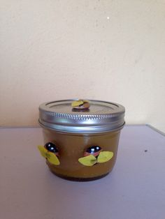 This beautiful beeswax candle is made with pure beeswax. I embellished the jar and lid with hand painted glass gem honey bees. This beeswax candle burns longer and brighter, and has a natural aroma and honey scent. Beeswax fuel is the only fuel that produces negative ions which help cleanse the air of dust, odors, toxins, pollen, mold, and viruses. Healing and spiritual powers have also been attributed to products of yhe beehive! no harmful chemicals have been added, and they burn clean.