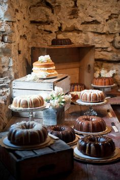 The delicious array of cakes lining the rustic dessert table were made by the bride and groom's family and friends.
