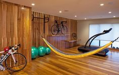 elegant-white-hammock-interior-design-in-garage-with-lighting-idea-in-ceiling-as-well-wooden-wall-and-flooring-along-with-glass-window-in-the-nearby.jpg