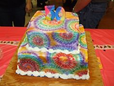 Tie Dye Cake - This was for my dad's 50th birthday. My mom had chosen a 60's theme for the party and mostly everyone showed up in tie dyed shirts. I decided to try out the rainbow cake method I'd seen on YouTube with this cake and it worked really well. Everyone was really surprised when they cut the cake open. No one wanted the top layer chocolate cake; they all wanted to try the rainbow cake. :)