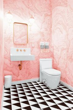 pink bathroom with black and white tile and marble wallpaper and brass accents via /citysage/