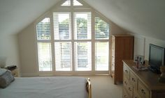 House Blinds can accommodate the majority of irregular window shapes. The best type of blinds for these types of windows are shutters, faux wood blinds, honeycomb shades, venetian blinds and silhouette sheers. Interior Balcony, Interior Shutters, Window Shutters, Window Blinds, House Blinds, Blinds For Windows, Curtains With Blinds, Attic Rooms, Attic Spaces