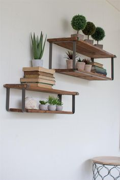 "MAXWELL'S RECYCLED WOOD AND METAL SHELVES SET OF 2 Price: $122.50 Item Number: GGKAQ6915 These are currently our favorite wall shelves, they have a industrial look, yet can be incorporated into the most elegant spaces. Made of Recycled Wood and Metal Dimensions: large 36"" x 10.5"" x 10.5""t small 30"" x 7"" x 7""t"