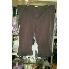 """St. John's Bay Brown Capri Pants These brown capri pants are pre-loved but in great condition. Brand is St. John's Bay and the size is 20W. The capris have multiple pockets and can be rolled down to be longer. Measurements are approx. 21"""" waist and approx. 28 1/2"""" length. All items come from a smoke/pet free home. Bundle items for a better price! St. John's Bay Pants Capris"""