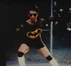 Prince in a batman crop top and string vest
