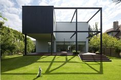 "Black Cube House by KameleonLab, a makeover of a ""typical polish family house from the 70s"" in Wroclaw."