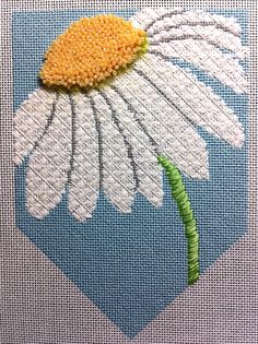 HUGS AND STITCHES, needlepoint daisy banner