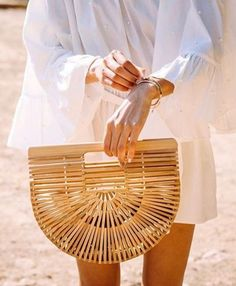 The Cult Gaia bamboo bag is the It accessory of the season.