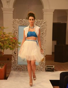 Aquamarine bandeau-bra top (INR 1790) under a white cut-out embroidered bolero (INR 2990) and net bubble-skirt with wrapping-dori belt (INR 2290)