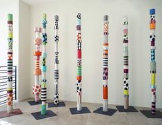 These are ceramic totems made by an artist inspired by indigenous forms....but I'm thinking this could be done as a collaborative class project using different sized tin cans....paint them white with gesso and let the kids paint a pattern on their own can...layer the cans every other with white cans!
