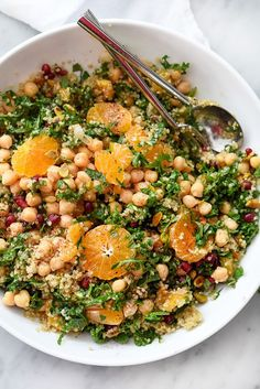 Quinoa, chickpeas (garbanzo beans) and pistachios add protein and healthy fat to this simple and seasonal kale salad, making it a favorite side dish or vegetarian main meal.