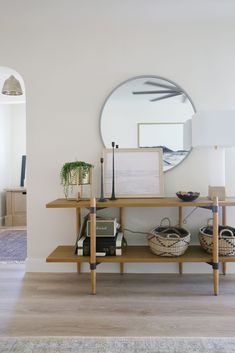 Beautiful modern entryway with console table, round mirror and artwork - juniper design studio Entryway Furniture, Entryway Decor, Entryway Ideas, Foyer, Home Decor Styles, Home Decor Accessories, Dining Pendant, White Armchair, Black Leather Sofas