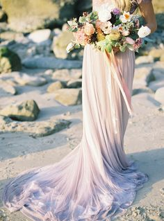 photo by Michael Radford, flowers by Tinge Floral, gown by Emily Riggs Bridal.