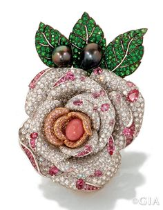 The Princesse de Monaco rose brooch. Courtesy Mikimoto (America) Co., Ltd.The Princesse de Monaco rose brooch is a breathtaking work. A rare natural pink conch pearl glows in the center. Tahitian pearl buds and demantoid garnet leaves crown the piece. The workmanship is equally impressive–setting round, pear, oval, and marquise shaped pink diamonds and round white diamonds on a concave surface