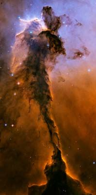 A billowing tower of gas and dust rises from the stellar nursery known as the Eagle Nebula. This small piece of the Eagle Nebula is 57 trillion miles long (91.7 trillion km).