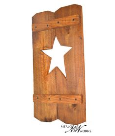 $20.00 These charming shutters are perfect next to a window! Hang it outside or inside, on both sides of one window, or all of your windows! Finished wood with star-shaped cut out Handmade from recycled materials by a skilled woodworker. Each shutter sold separately.