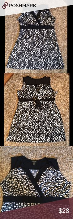 Lane Bryant black and white mock wraparound dress Size 26/28 excellent condition! Black and white polka dots with small lines connecting them. Ties in backs sleeveless. MIDI length! Lane Bryant Dresses Midi