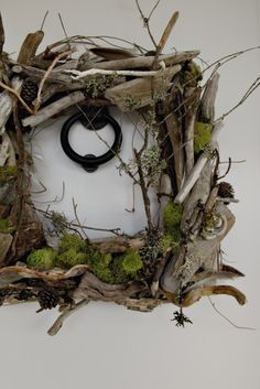 Square wreath made from hand collected driftwood. Browse driftwood crafts on Completely Coastal: http://www.completely-coastal.com/search/label/Driftwood%20Crafts