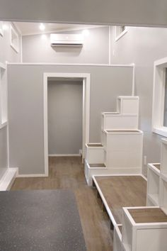 Upper Valley Tiny Homes used a soft gray for the interior walls and white for the crown moulding and trim, giving the tiny house a clean, modern finish.
