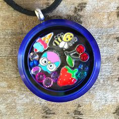 Complete Set with random charms and blue acrylic locket