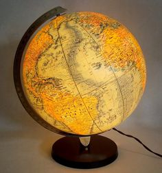Replogle World Globe Vision Series  by Vintiquesandmore on Etsy ~It's a Globe!  It's a lamp!  Cool accent lighting for the home office, or the little explorer's room!