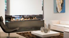 The ultimate modern gas fire, the suspended fireplace with its suspended canopy can incorporate a single flame up to in length. A suspended fireplace such as this is a fantastic design to incorporate in a large open space to create Suspended Fireplace, Hanging Fireplace, Open Fireplace, Fireplace Remodel, Fireplace Wall, Fireplace Design, Fireplace Ideas, Fireplace Modern, Living Room Tv