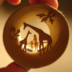 Toilet paper roll scenes by Anastassia Elias. This one is a mother and child looking at the giraffes at a zoo.