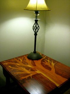 using a stencil with stain; don't love the tree but a pattern might look cool