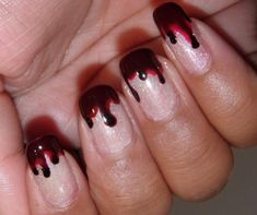 bloody tipped nails - (via @Amanda Mitchell)