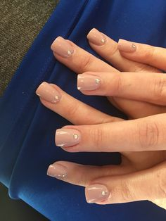 Nude acrylic nails with diamond accent