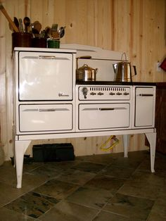 1920's Wedgewood stove with wood burner on the side. Compatible with our off-grid life.