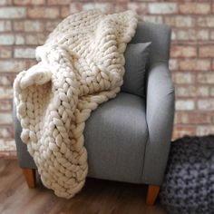 This super chunky hand-knitted decorative throw makes an impact in any room.Two sizes are available, both are designed to fit double beds. As I make each throw by hand they can easily be made in other sizes or coloured so please feel free to get in touch via the 'Ask seller a Question' button above.This product is a truly unique show-stopper, hand-processed and knitted on giant needles in my Devonshire studio. The merino wool is unbeatably soft and cosy with a simple stockinette stitch…