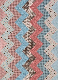 Sew a soft and cuddly baby quilt with a zigzag pattern.